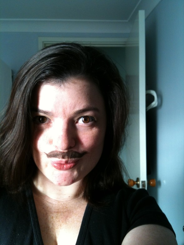 Jess with a moustached drawn in eyeliner