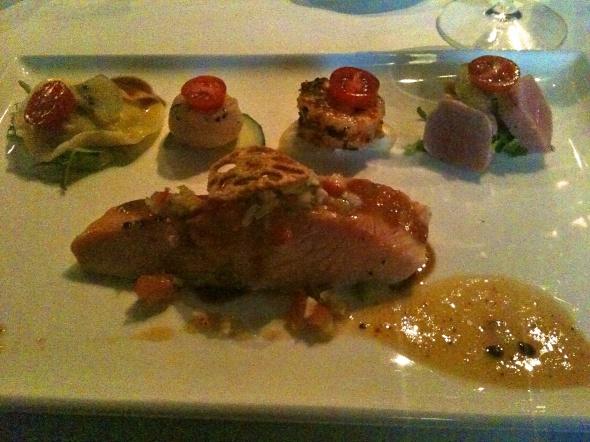 Plate with salmon, seafood gyoza, scallop, prawn and tuna